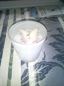 Vanilla scented candle with a butterfly for Ulla's Vigil